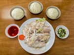 Hainanese chicken is a specialty Chinese plate of cut up chicken.