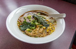 Ramen with noodles, meat, corn, vegetables in a broth that takes 6 hours to make.