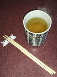 Japanese green tea with chopsticks.