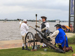Pirates shoot off canon during Contraband Days in Lake Charles, Louisiana, celebrating the days of pirate Jean Lafitte.