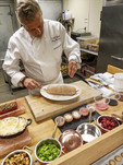 Culinary Director Roy Breiman prepares a foie gras at Cedarbrook Lodge's gourmet Copperleaf restaurant.