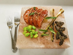 Salmon sashimi with butter poached morel mushrooms, salt roasted spring onions and fava beans resting on Himalayan sea salt slab.