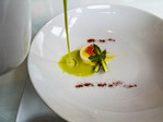 Pouring asparagus soup over quail egg and salmon roe with tiny asparagus at Cedarbrook Lodge's Copperleaf Restaurant.