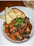 Steamed P.E.I mussels in smoky roasted tomato cream sauce. Served at Eleven22 restaurant in Golden, BC.