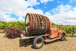 Antique truck with huge wine barrel out front of Cassini Cellars in southern Okanagan Valley, BC, Canada.