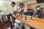 Chef Chris Van Hooydonk and his assisting chef at Backyard Farm in the Okanagan Valley area of BC, Canada.