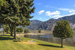 Watermark Resort, on the shores of Osoyoos Lake in Osoyoos, BC, Canada. Visitors swim, kayak, paddleboard, SUP and relax.