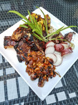 Assorted grilled meats (steak, ribs, pork sausages)