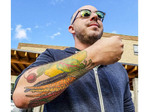 Food writer Dan Clapson shows off his tattoos of, what else? vegetables.