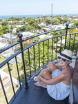 Woman enjoys view from the top of the Key West Lighthouse museum, built in 1848.
