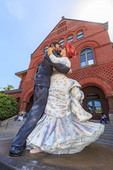 Huge Seward Johnson statue of a man and woman ballroom dancing in front of The Custom House near Mallory Square.