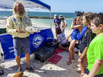 Dr. David Vaughan, executive director of Mote Marine Tropical Research Lab, explains reef restoration project at Fort Zachary Tailor state park.