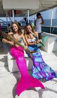 "Two ""mermaids"" practice performing for the Lower Keys Underwater Music Festival"