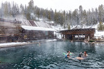 People soak in the 100 degree water of the main pool at Burgdorf Hot Springs near McCall, ID, during a light snowfall.