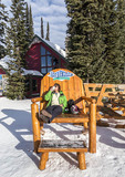 Woman skier has a coffee jolt before hitting the ski slopes at Big White in British Columbia, Canada.