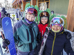 Women in Big White Ski Resort Masters ski program show off their green hair helmet decorations.