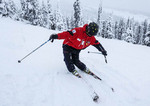 Instructor at Big White ski resort shows an exaggerated proper stance for skiing.