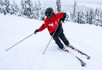 Instructor at Big White ski resort shows an exaggerated wrong stance for skiing. You don't want to lean into the hill.