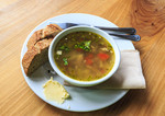 Fresh, home made, organic chicken and vegetable soup with fresh baked bread, served for lunch at the Fickle Fig Farm outside Victoria, BC, Canada