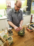 Whipping up matcha tea (a Japanese green tea) at Just Matcha in Victoria's Chinatown. Vancouver Island, BC, Canada.