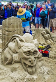 Sandcastle Contest along Cannon Beach in Oregon, USA. Teams compete to sculpt elaborate scenes made of sand.