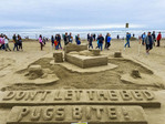 Large Group Division Winner, Pugs, at sandcastle Contest along Cannon Beach in Oregon, USA.