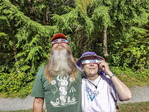 Man and woman watch the solar eclipse begin using protective glasses. Near Seattle, WA, Aug. 21, 2017