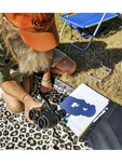 Man uses binoculars backwards to cast crescents of light on paper while watching solar eclipse. Aug. 21, 2017.