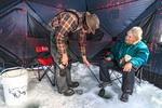 Ice fishing on Heffley Lake near Sun Peaks Resort with Elevated Fishing Adventures.