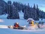 Snow cat groomer making the ski run smooth for skiers the next day. Sun Peaks Resort. British Columbia, Canada