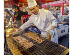 Chef James Chen  grills assorted meats (beef, lamb and chicken) along with shrimp at Richmond Night Market, Richmond, British Columbia, Canada.