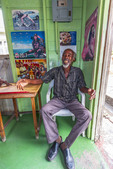 Local elderly man inside a rum shop in Bridgetown, Barbados in the Caribbean.