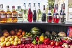 Rum, liquors, flavorings and assorted fruit, vegetables and spices set out for rum cocktail competition at Mount Gay Rum distillery