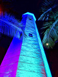 Night view with colored lights of Needham's Point lighthouse, on the southwest coast of Barbados on Hilton property.