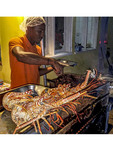 Huge lobsters on the grill during Oistins weekend fish fry. Barbados.
