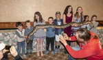 """Children hold a Burmese python during the evening """"Critter Show"""" at White Stallion Ranch."""