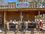 Saddles with their horse's names, waiting to be used at White Stallion Ranch outside Tucson, AZ.