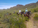 Guests on slow ride at White Stallion Ranch, a dude ranch outside Tucson, AZ.