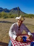 Ranch wrangler eats breakfast during breakfast ride at White Stallion Ranch outside Tucson, AZ.