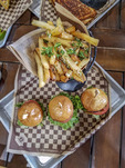 Sliders and truffle fries plus beer tasting at Twin Sisters Brewing Co. It's located in a reconstructed ware house on the edge of a Bellingham, WA, industrial district. Food including their signature hamburgers and locally brewed beer ranging from unique (Strawberry Zwickelbier made with real strawberries) to their Bellingham Green IPA.