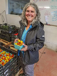 Cheryl Thornton, market development coordinator, talks about how Cloud Mountain Farm helps support young farmers. Here, she holds some of the farm's cherry tomatoes.
