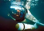"Pilot/inventor, Graham Hawkes, operates winged submersible ""Deep Flight I"" during test dives in Monterey Bay, California."