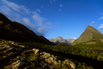 Garden Wall and Grinnell Point above Swiftcurrent Lake and rock ledges, view from near Many Glacier Lodge