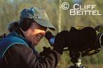 birder using high-powered spotting scope