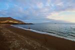 Volcanic sand beach, schooner Beagle anchored offshore