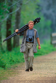 Photographer Tom Vezo carrying 600mm lens (1997)