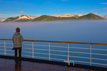 Traveler, stern of M/S Oosterdam, viewing icy peaks above fog, Chatham Strait, Inside Passage