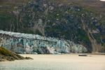 Small ship anchored off Lamplugh Glacier