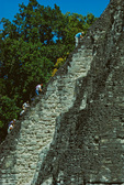 Visitors climbing steep steps of Temple I, Great Plaza