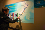 Ian Cooke with display showing distribution of penguins around New Zealand, International Antarctic Centre